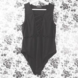 Top Chic black caged cutouts bodysuit